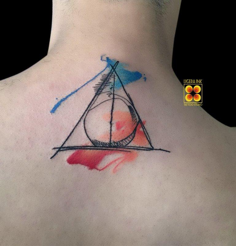 Ligera-ink-tattoo-milano-tatuaggi-milano-migliori-tatuatori-milano-tatuaggio-watercolor-milano-tattoo-watercolor-milano-tatuaggio-harry-potter-tatuaggio-i-doni-della-morte