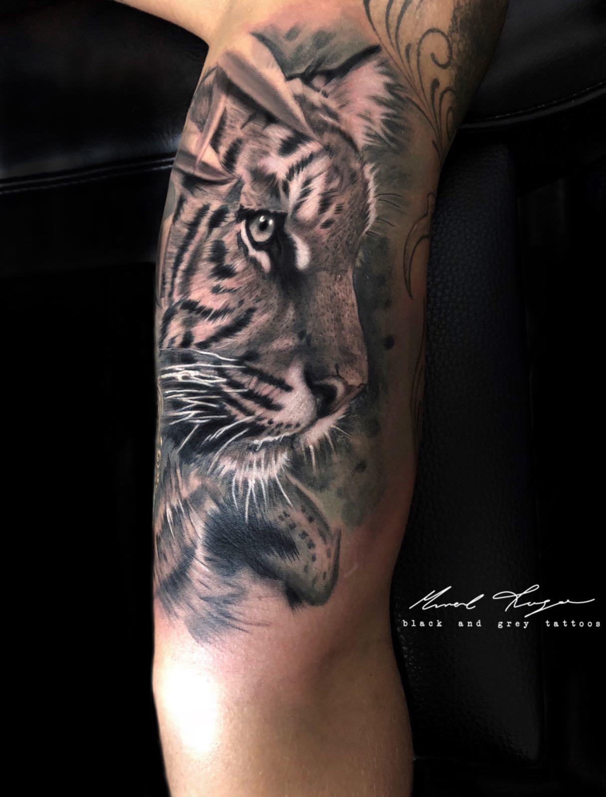 Ligera-ink-tattoo-milano-tatuaggi-milano-migliori-tatuatori-milano-tatuaggio-tigre-realistico-tattoo-tigre-realistica